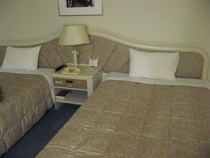 洋室のお部屋・ベッド