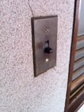 客室前の廊下の照明スイッチ