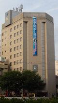 コンフォートホテル岡山の「チェックアウトは12時」の垂れ幕