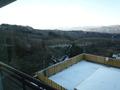雪に覆われる屋上テラス