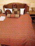 ダブルルームのベッド